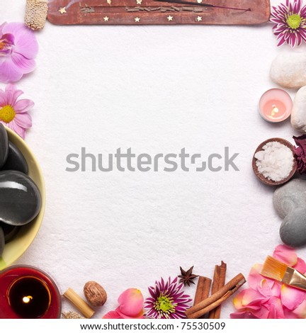 Frame made from spa accessories over white towel. - stock photo