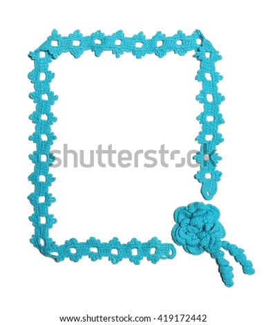 Frame made of knitted wool lace - stock photo