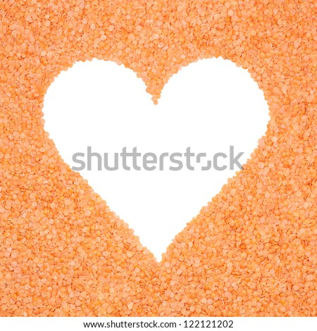 Frame made of lentils in the shape of a heart with clipping path - stock photo