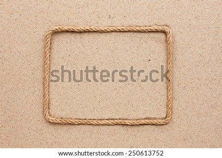 Frame made of rope lying on the sand, as background - stock photo