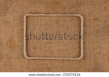 Frame made of rope with space for your text, lying on sackcloth - stock photo