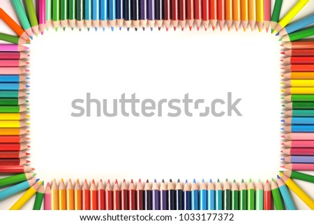 Frame made out of color pencils with space for text isolated on a white background