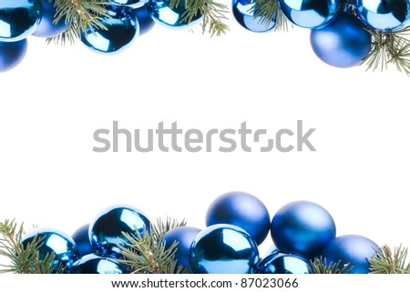frame made with blue christmas baubles and pine leaves isolated in white with copy space