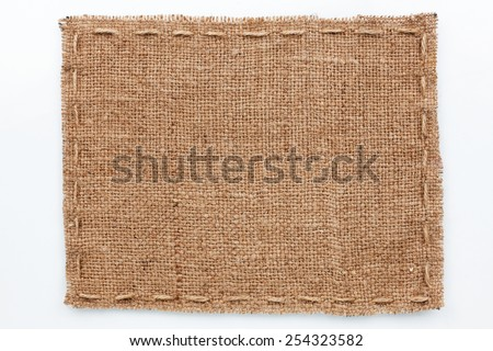 Frame of burlap  lies on a white  background, with place for your text - stock photo