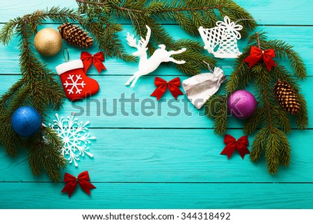 Frame of Christmas tree with different toys and accessories on blue wooden background. Top view - stock photo