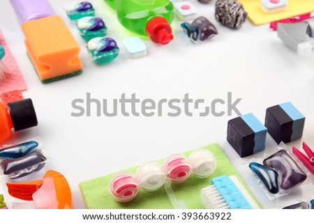 Frame of cleaning products and tools on white background