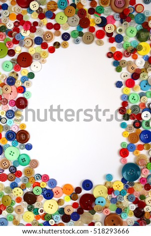frame of colorful buttons isolated on white background. vertical