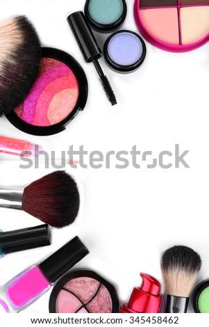 Frame of decorative cosmetics on white background - stock photo
