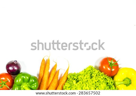 Frame of fresh vegetables on white background - stock photo