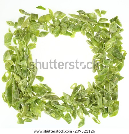 frame of frozen chopped French beans over white - stock photo