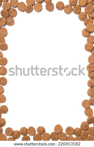 Frame of gingerbread nuts or pepernoten, typical Dutch candy for a dutch holiday sinterklaas on the fifth of december - stock photo