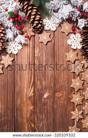 Frame of gingerbreads and winter decor on a wooden background. - stock photo