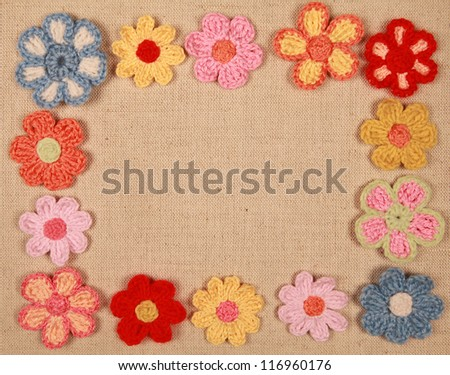 frame of knitted flowers - stock photo