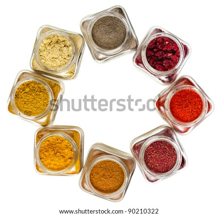 frame of powder colorful spices in glass bottle, top view,  isolated on white background - stock photo