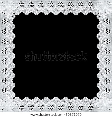 Frame of white lace, isolated on black background
