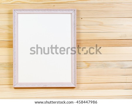 Frame on wooden wall. Interior Design. Copy space.