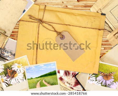 Frame with old envelope and photos - stock photo