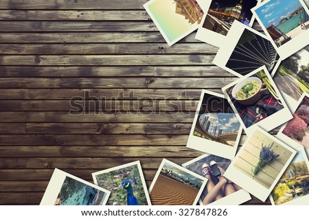 Frame with old photographs of paper, on wooden background - stock photo
