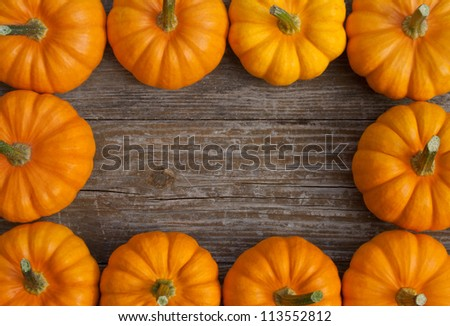 frame with pumpkins on a wooden table/pumpkins/autumn - stock photo