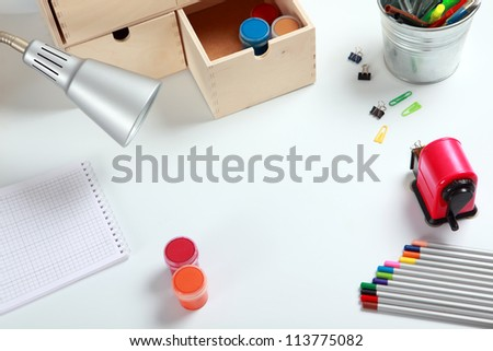 Frame with school accessories on the desk - stock photo