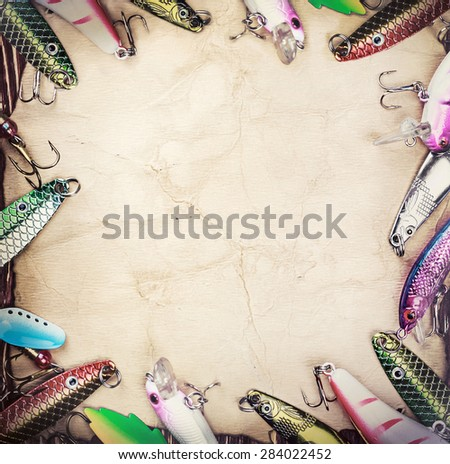 Frame with spinner lures and fishing bait. Frame with spinner lures and fishing bytes. Place empty can be used for text - stock photo