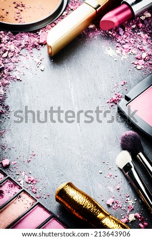 Frame with various makeup products in pink tone - stock photo