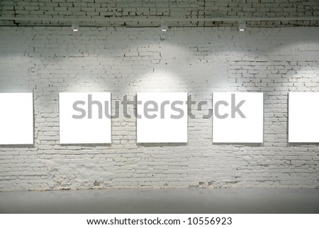 frames on brick wall - stock photo