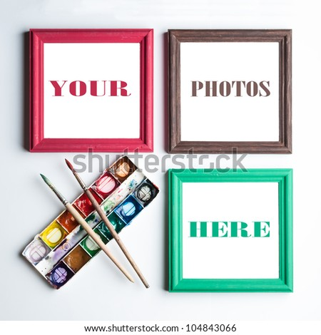 Frames, palette of watercolor paints and paint brushes. Places for your photo or text. - stock photo