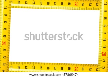 Framework from a yellow measuring tape - stock photo