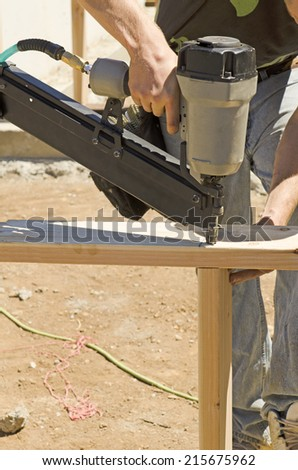 Framing contractor installing a wood frame cripple wall on the foundation of a new custom luxury home - stock photo