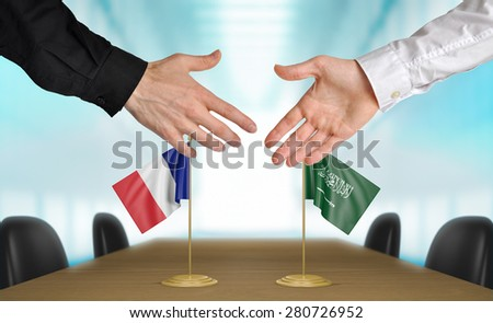 France and Saudi Arabia diplomats agreeing on a deal - stock photo
