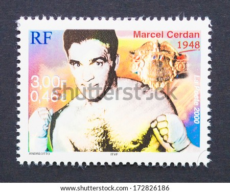 FRANCE - CIRCA 2000: a postage stamp printed in France showing an image of Marcel Cerdan, circa 2000.  - stock photo