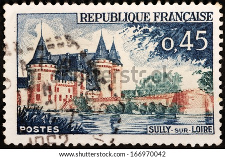 FRANCE - CIRCA 1961: A stamp printed by FRANCE shows image of Sully-sur-Loire castle, the historic seat of the dukes de Sully, circa 1961