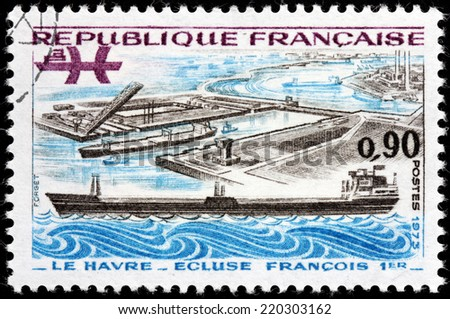 FRANCE - CIRCA 1973: A stamp printed by FRANCE shows view of Oil Tanker and Francis I Lock in Le Havre, the Seine-Maritime department, the Haute-Normandie region, France, circa 1973 - stock photo