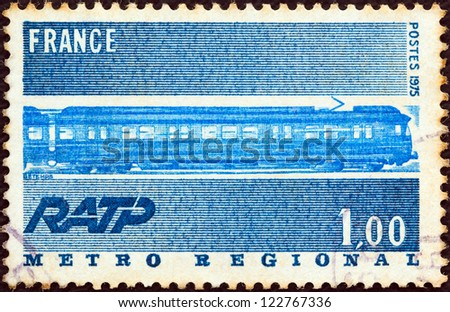 FRANCE - CIRCA 1975: A stamp printed in France issued for the opening of Metro Regional Express Service shows underground train, circa 1975. - stock photo