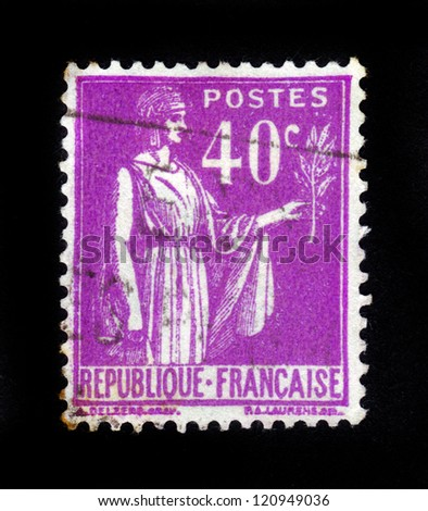 "FRANCE - CIRCA 1933: A stamp printed in France shows a woman with an Olive Branch in hand - allegory of Peace , from the series ""Peace"", circa 1933"