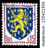 "FRANCE - CIRCA 1960: A stamp printed in France shows coat of arms of Nevers (capital of Nievre department in Bourgogne) in France, with the same inscriptions, series ""Arms of French Towns"", circa 1960 - stock photo"