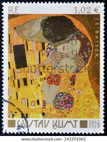 FRANCE - CIRCA 2002: A stamp printed in France shows famous picture The Kiss (Le Baiser) by Austrian symbolist painter Gustav Klimt, circa 2002  - stock photo