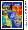FRANCE - CIRCA 1998: a stamp printed in the France shows Faces of People of Various Races, Globe, 50th Anniversary of Universal Declaration of Human Rights, circa 1998 - stock photo
