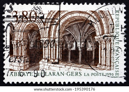 FRANCE - CIRCA 1990: a stamp printed in the France shows Flaran Abbey, former Cistercian Abbey Located in Valence-sur-Baise, in the Department of Gers, France, circa 1990 - stock photo