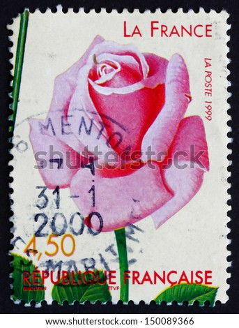 FRANCE - CIRCA 1999: a stamp printed in the France shows La France, World Old Roses Competition, Lyon, Purple-throated Carib, Eulampis Jugularis, Bird, circa 1999 - stock photo