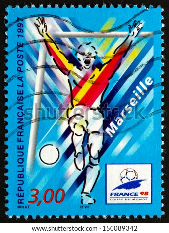 FRANCE - CIRCA 1997: a stamp printed in the France shows Marseilles, Host City of 1998 World Cup Soccer Championships, Stylized Action Scene, circa 1997 - stock photo