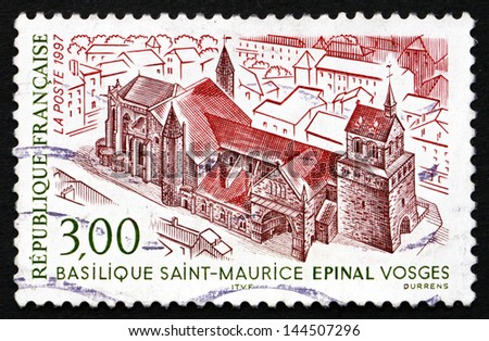 FRANCE - CIRCA 1997: a stamp printed in the France shows Saint Maurice Basilica, Epinal, Vosges, circa 1997 - stock photo