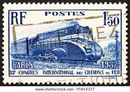 FRANCE - CIRCA 1937: a stamp printed in the France shows Streamlined Locomotive, 13th International Railroad Congress, circa 1937 - stock photo