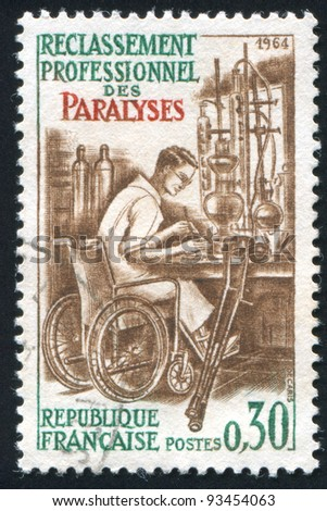 FRANCE - CIRCA 1964: stamp printed by France, shows Handicapped Laboratory Technician, circa 1964 - stock photo