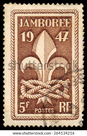 FRANCE - CIRCA 1947: stamp printed in France, shows Scout Jamboree Emblem, circa 1947 - stock photo