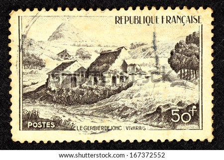 FRANCE - CIRCA 1949: Stamp printed in France with image of Mont Gerbier de Jonc in the rural landscape of the Vivarais region in the south-east of France, circa 1949.
