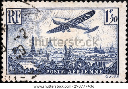 FRANCE - FEBRUARY, 1936: A stamp printed by FRANCE shows Plane flying over Paris. Beautiful Paris cityscape with Eiffel tower, Notre Dame Cathedral and Sacre Coeur in Montmartre hill - stock photo