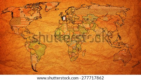 france flag on old vintage world map with national borders - stock photo