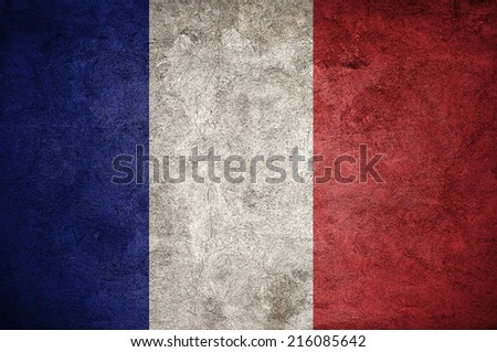 France flag on the grunge concrete wall - stock photo